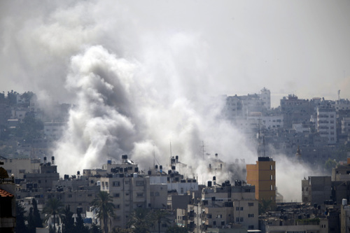 Smoke from an Israeli strike rises over Gaza City, Wednesday, July 23, 2014. Israeli troops battled Hamas militants on Wednesday near a southern Gaza Strip town, sending Palestinian residents fleeing, as the U.S. secretary of state presses ahead with top-gear efforts to end the conflict that has killed hundreds of Palestinians and tens of Israelis.(AP Photo)