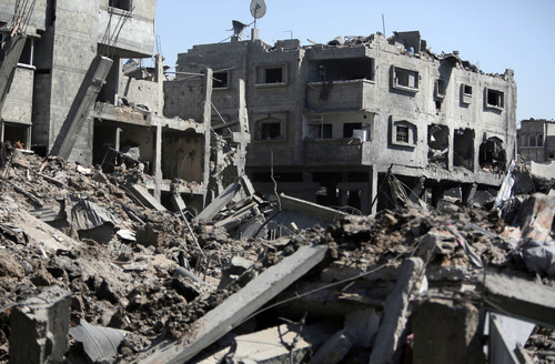 A general view shows the destruction in Gaza City's Shijaiyah neighborhood, Wednesday, July 23, 2014. Israeli troops battled Hamas militants on Wednesday near a southern Gaza Strip town as the top U.S. diplomat reported progress in efforts to end fighting that has so far killed more than 600 Palestinians and more than 30 Israelis. (AP Photo/Khalil Hamra)
