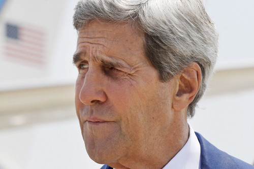 U.S. Secretary of State John Kerry arrives to Tel Aviv, Israel, Wednesday, July 23, 2014. Kerry is meeting with U.N. Secretary-General Ban Ki-moon, Israeli Prime Minister Benjamin Netanyahu, and Palestinian Authority President Mahmoud Abbas as efforts for a cease-fire between Hamas and Israel continues. (AP Photo/Pool)