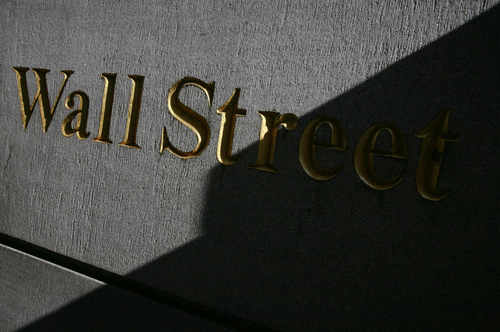 FILE - A sign for Wall Street is shown in this March 8, 2010 file photo near the New York Stock Exchange. Global stocks mostly rose Wednesday, July 23, 2014, bolstered by solid U.S. earnings and home sales as tensions between Russia and the West over Ukraine eased. (AP Photo/Mark Lennihan, File)