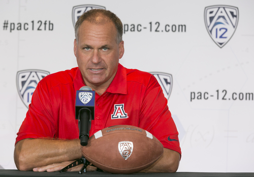 Arizona head coach Rich Rodriguez takes questions at the 2014 Pac-12 NCAA college football media days at Paramount Studios in Los Angeles Wednesday, July 23, 2014. (AP Photo)
