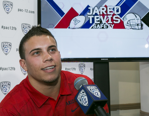 Arizona safety Jared Tevis is interviewed at the 2014 Pac-12 NCAA college football media days at Paramount Studios in Los Angeles Wednesday, July 23, 2014. (AP Photo)