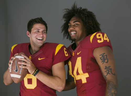 Southern California quarterback Cody Kessler, left, and defensive end Leonard Williams pose for photos at the  Pac-12 NCAA college football media days at Paramount Studios in Los Angeles, Wednesday, July 23, 2014. (AP Photo)