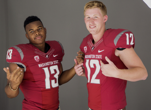Washington State linebacker Darryl Monroe, left, and quarterback Connor Halliday pose for photos at the 2014 Pac-12 NCAA college football media days at Paramount Studios in Los Angeles Wednesday, July 23, 2014. (AP Photo)