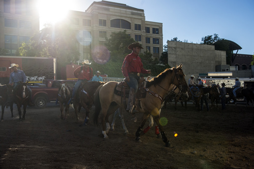 Chris Detrick  |  The Salt Lake Tribune Cowboys ride around outside before the Days of '47 Rodeo at EnergySolutions Arena Tuesday July 22, 2014.