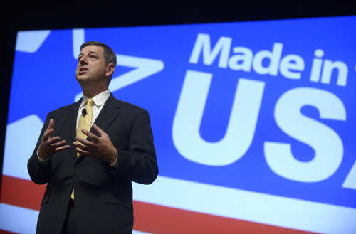 FILE - In this Aug. 22, 2013 file photo, Wal-Mart U.S. President and CEO Bill Simon addresses attendees of the Wal-Mart U.S. Manufacturing Summit in Orlando, Fla. Wal-Mart on Thursday, July 24, 2014 announced it is replacing Simon with Wal-Mart Asia CEO Greg Foran in what could be an indication that the company is losing confidence that its largest business unit will rebound after more than a year of disappointing results. (AP Photo/Phelan M. Ebenhack, File)