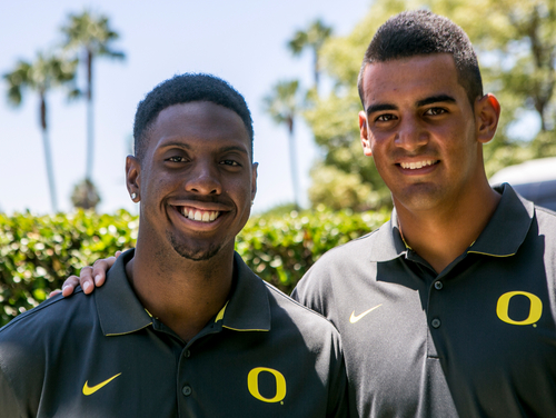 Oregon linebacker Derrick Malone, left, and quarterback Marcus Mariota pose for a photo at the Pac-12 NCAA college football media days at Paramount Studios in Los Angeles, Wednesday, July 23, 2014. (AP Photo)