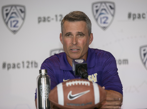 Washington head coach Chris Petersen takes questions at the 2014 Pac-12 NCAA college football media days at Paramount Studios in Los Angeles Thursday, July 24, 2014. (AP Photo)
