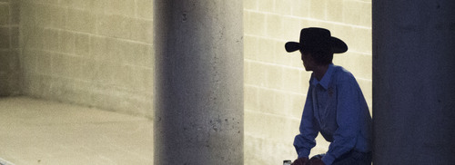 Steve Griffin     The Salt Lake Tribune   A cowboy sits on the chutes during the Days of '47 Rodeo at EnergySolutions Arena in Salt Lake City, Utah Wednesday, July 23, 2014.
