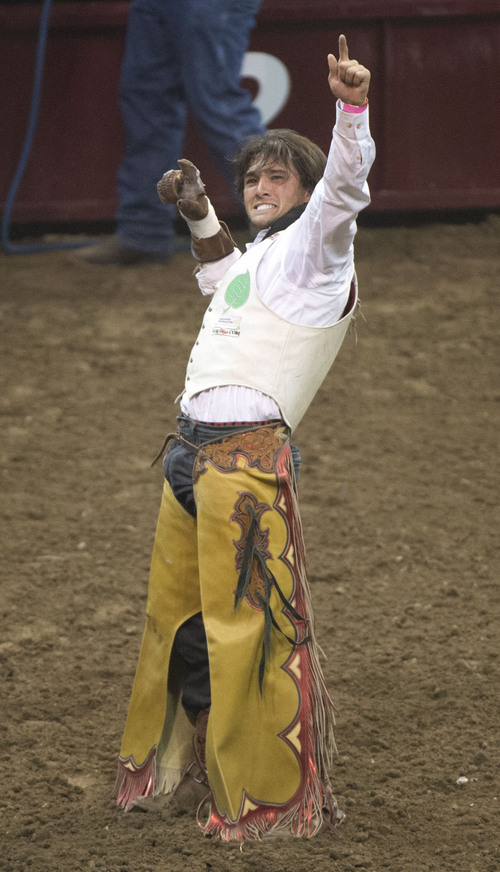 Steve Griffin     The Salt Lake Tribune   Caleb Bennett, of Morgan, Utah, salutes the crowd after scoring an 84 on his bareback ride during the Days of '47 Rodeo at EnergySolutions Arena in Salt Lake City, Utah Wednesday, July 23, 2014.