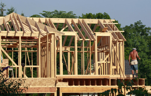 FILE - In this Wednesday, June 20, 2012, file photo, a worker stands in the early-morning sunlight on a home construction project in Newtown, Pa. The Commerce Department reports on sales of new homes in June later Thursday July 24, 2014. (AP Photo/Mel Evans, File)