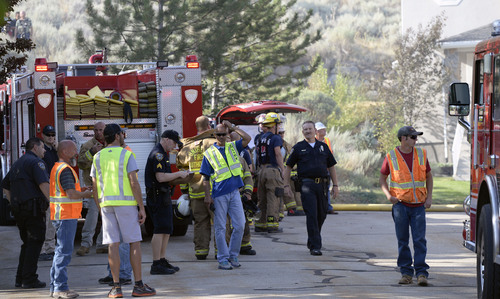 Al Hartmann  |  The Salt Lake Tribune  Unified Fire and emergency personnel respond to an explosion and fire at 15091 South Junction Circle in Draper Friday July 25.
