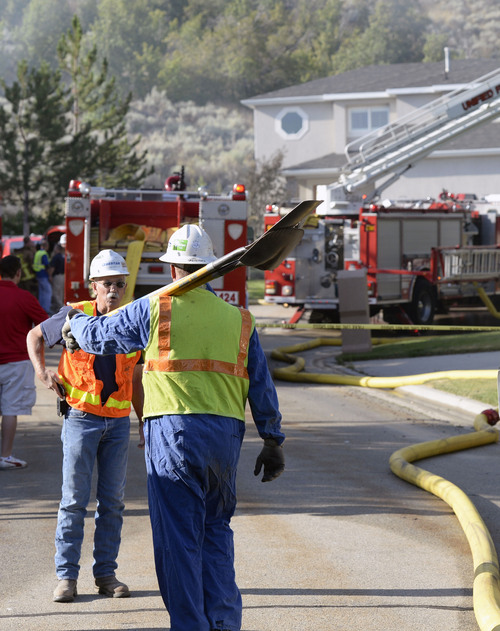 Al Hartmann  |  The Salt Lake Tribune  Unified Fire and emergency personnel respond to an explosion and fire at 15091 South Junction Circle in Draper on Friday.