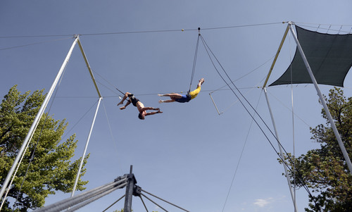 Al Hartmann  |  The Salt Lake Tribune  Utah Flying Trapeze is open at the the south side of Pioneer Park Wednesday July 23.  A trapeze set complete with safety harnesses, nets and instruction will be offered to the public throughout weekdays by the Utah Flying Trapeze group.