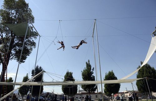Al Hartmann  |  The Salt Lake Tribune  Utah Flying Trapeze open at the the south side of Pioneer Park Wednesday July 23.  A trapeze set complete with safety harnesses, nets and instruction will be offered to the public throughout weekdays by the Utah Flying Trapeze group.