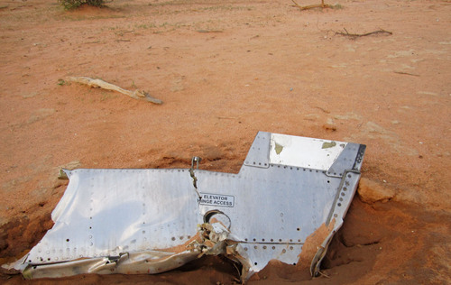 This photo provided on Friday, July 25, 2014,  by the Burkina Faso Military shows a part of the plane at the crash site,  in Mali. French soldiers secured a black box from the Air Algerie wreckage site in a desolate region of restive northern Mali on Friday, the French president said. Terrorism hasn't been ruled out as a cause, although officials say the most likely reason for the catastrophe that killed all onboard is bad weather. At least 116 people were killed in Thursday's disaster, nearly half of whom were French. (AP Photo/Burkina Faso Military)