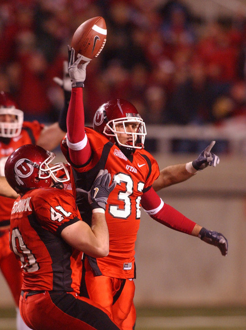 Tommy Hackenbruck (left)  celebrates with Eric Weddle, after his interception, in Footballl action, Utah vs CSU at Rice-Eccles stadium Saturday night.  11/06/2004