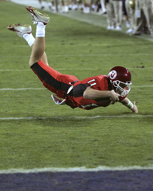 Utah quarterback Alex Smith falls short of the touchdown at the fourth yard line in the first quarter against Pittsburgh at the Fiesta Bowl, Saturday, Jan. 1, 2005 in Tempe, Ariz.. Smith handed off to Quinton Ganther on the next play for Utah's first touchdown.  (AP Photo/Matt York)