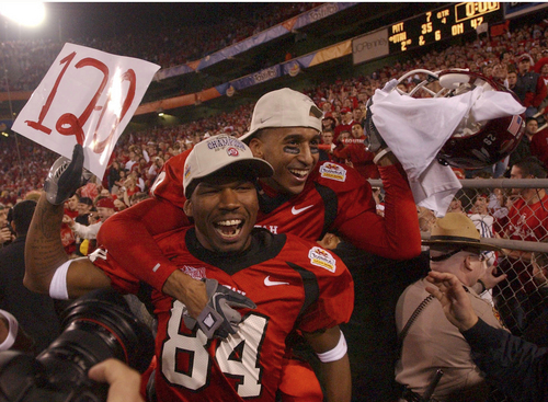l-r Thomas Huff and Ryan Smith celebrate the Utes victory in the Fiesta Bowl at SunDevil Stadium, in Tempe, Arizona. 1/1/2005 photo by Rick Egan