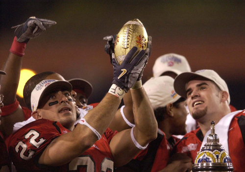 Bo Nagahi (left) and Tommy Hackenbruck holding the jewel-encrusted football from the top of the Fiesta Bowl trophy. Utah vs. Pittsburgh, Fiesta Bowl, Tempe. Photo by Trent Nelson; 1.01.2005