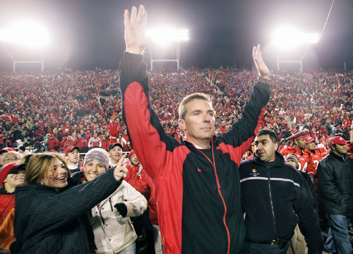Utah Head coach Urban Meyer raises his hands as time runs out. Utah Beats BYU to go 11-0. photo by Danny Chan La 11-20-04