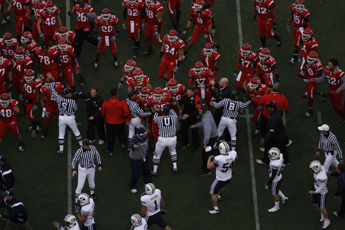 Officials break up a scuffle between Utah and BYU football players before their game Saturday at Rice-Eccles Stadium. Chris Detrick/The Salt Lake Tribune/November 22, 2008