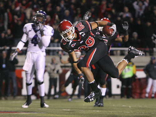 Utah receiver Freddie Brown, right, scores the winning touchdown in the final minute of play in front of TCU's Steven Coleman. The 10th-ranked Utes defeated No. 11 TCU 13-10 at Rice-Eccles Stadium on Thursday, November 6, 2008.  Scott Sommerdorf / The Salt Lake Tribune