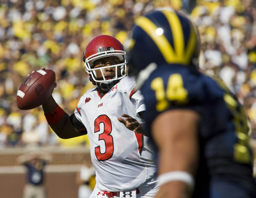 Michigan cornerback Morgan Trent, right, watches Utah quarterback Brian Johnson throw a pass in the first half of the Utes' 25-23 win over the Wolverines on Saturday, Aug. 30, 2008, in Ann Arbor, Mich. (AP Photo/Tony Ding)