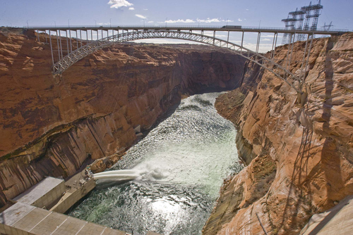 Paul Fraughton  | Tribune file photo Low flows on the Colorado River have forced water authorities to take the historic step of reducing the outflow of water from Glen Canyon Dam, which forms Lake Powell, creating great concern among downstream users such as Las Vegas.