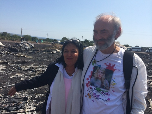 "Jerzy Dyczynski and Angela Rudhart-Dyczynski whose daughter, 25-year-old Fatima, was a passenger on Malaysia Airlines flight MH17, look over the wreckage of the crashed aircraft in Hrabove, Ukraine, Saturday, July 26, 2014. The couple who live in Perth, Australia, crossed territory held by pro-Russian rebels to reach the wreckage-strewn farm fields outside the village of Hrabove. They last spoke to Fatima shortly before she boarded the flight for Kuala Lumpur in Amsterdam on July 17. Rudhart-Dyczynski said, ""We have promised our daughter we will come here.""  (AP Photo/Nicholas Garriga)"