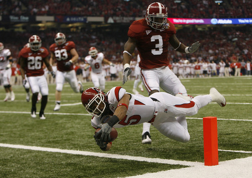 Chris Detrick   The Salt Lake Tribune  Utah wide receiver Brent Casteel (5) dives into the endzone past Alabama cornerback Kareem Jackson (3) to score the first touchdown of the game as the Utes face Alabama in the 75th Anniversary Sugar Bowl in New Orleans, Louisiana, Friday, January 2, 2008.