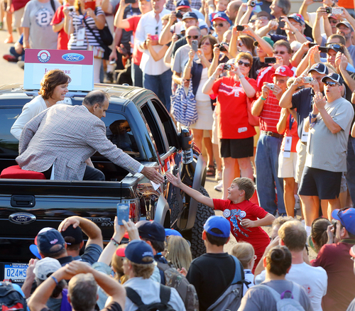 Former New York Yankees manager Joe Torre gets five from a young fan during the Hall of Fame Legends Parade down Main Street on Saturday, July 26, 2014, in Cooperstown, N.Y. (AP Photo/Atlanta Journal-Constitution, Curtis Compton) GWINNETT OUT; MARIETTA OUT; LOCAL TELEVISON OUT (WXIA, WGCL, FOX 5)