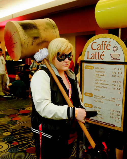 Trent Nelson  |  The Salt Lake Tribune Asia Kelson, dressed as Harley Quinn, stops in for a snack at Caffe Latte, during Salt Lake Comic Con in Salt Lake City in September 2013.