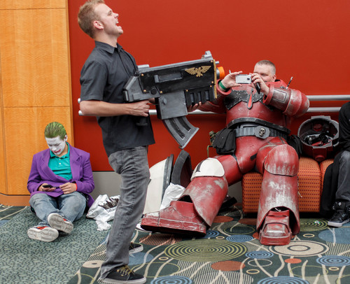 Trent Nelson  |  The Salt Lake Tribune Warhammer 40K Space Marine Jon Robinson snaps a photo of George Hall, center, at Salt Lake Comic Con in Salt Lake City Saturday, September 7, 2013. At left is Dakota Renee White as The Joker.