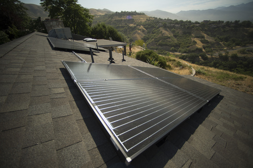 Rick Egan     The Salt Lake Tribune  Stan Holmes installed solar panels on his roof, Rocky Mountain power wants net-metered customers like Holmes, who have invested thousands in solar arrays to pay a monthly fee, Friday, July 25, 2014