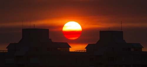 Steve Griffin  |  The Salt Lake Tribune   The sun glows red as it sets behind Medical Plaza Towers on the University of Utah campus in Salt Lake City, Utah Tuesday, July 22, 2014.