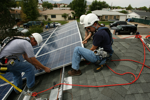 Leah Hogsten     The Salt Lake Tribune  SLCC students l-r Alan Naumann, Jeremy Smith and Mark Price install solar panels on a home in Kearns.