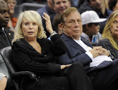 FILE - In this Nov. 12, 2010, file photo, Shelly Sterling sits with her husband, Donald Sterling, right, during the Los Angeles Clippers' NBA basketball game against the Detroit Pistons in Los Angeles. With a $2 billion sale of the Clippers hanging in the balance, a judge is set to determine Monday, June 30, 2014, if the terms of a family trust alone are enough to confirm Donald Sterling was properly removed as trustee and allow his estranged wife to sell the team without his consent. (AP Photo/Mark J. Terrill, File)