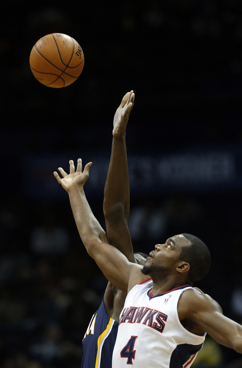 Atlanta Hawks power forward Paul Millsap (4) is shown against the Indiana Pacers in the first  half of an NBA basketball game Tuesday, Feb. 4, 2014, in Atlanta (AP Photo/John Bazemore)