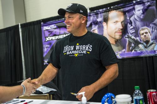Chris Detrick  |  The Salt Lake Tribune Adam Baldwin shakes hands with a fan at Salt Lake Comic Con FanXperience at the Salt Palace Convention Center Saturday April 19, 2014.