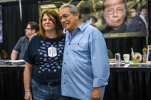 Chris Detrick  |  The Salt Lake Tribune Edward James Olmos poses for a picture with Angela Wilkins, of West Bountiful, at Salt Lake Comic Con FanXperience at the Salt Palace Convention Center Saturday April 19, 2014.