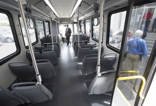 Steve Griffin  |  The Salt Lake Tribune   UTA officials climb on board for a ride around town in a Proterra battery electric 40-foot bus at UTA offices in Salt Lake City, Utah Monday, July 28, 2014. UTA is considering buying some of the $825,000 buses.