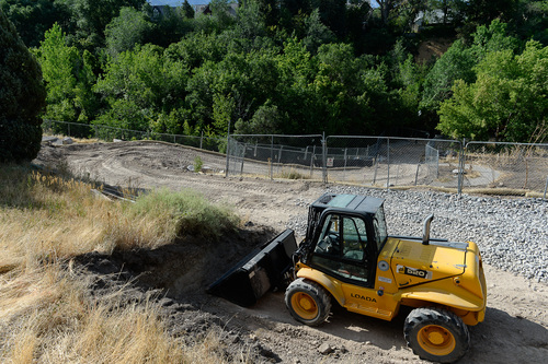 Francisco Kjolseth  |  The Salt Lake Tribune Work has begun on the tree thinning and bank stabilization project at Miller Park Bird Refuge that has been controversial and is expected to be closed until about November. A road has been cut to facilitate moving heavy equipment to the banks of Red Butte Creek.