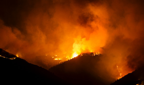 Steve Griffin  |  The Salt Lake Tribune   a wildfire burns in the mountains in Levan, Utah Thursday, July 24, 2014.