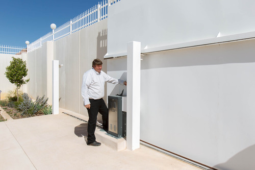 Trent Nelson     The Salt Lake Tribune Willie Jessop hand cranks open a large metal gate to a compound in Hildale, Friday April 26, 2013. The property was purchased by Willie Jessop who spent the day allowing former followers to see the inside of a compound they had previously not been allowed to enter.