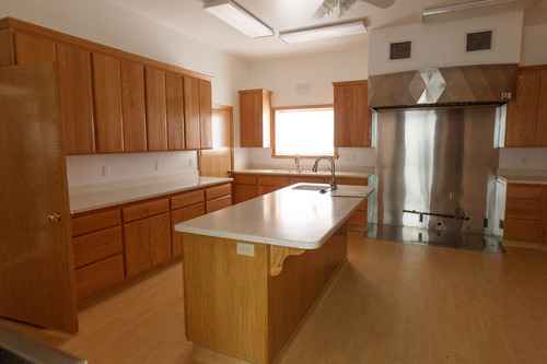 Trent Nelson     The Salt Lake Tribune A kitchen inside a home intended for the family of Warren Jeffs in Hildale, Friday April 26, 2013. The property was purchased by Willie Jessop who spent the day allowing former followers to see the inside of a compound they had previously not been allowed to enter.
