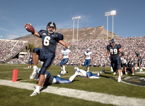 BYU's Luke Staley crosses the goal line for the cogars. Staley  maked up for last week with  his first of two touchdowns in the  first half agains Air Force Academy.  photo by rick egan  10-20-2001