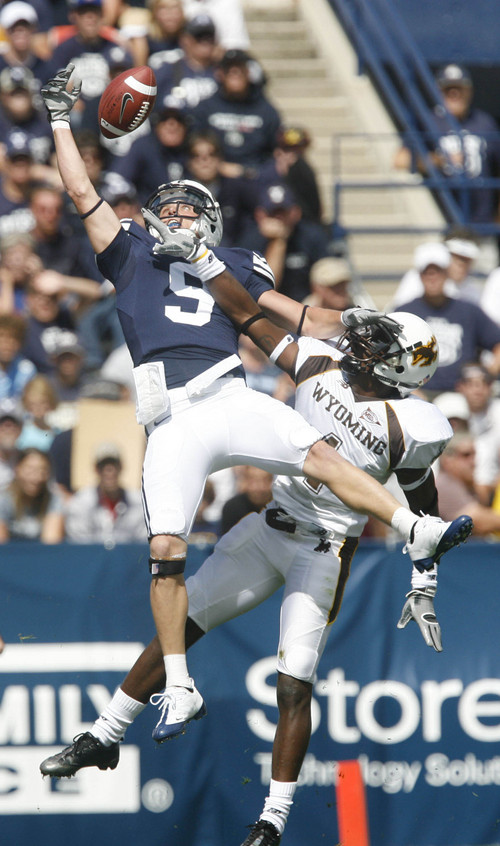 Though Austin Collie can't haul in this pass, the Cougar receiver did have two touchdown receptions in BYU's 44-0 shutout of Wyoming.  Rick Egan/The Salt Lake Tribune