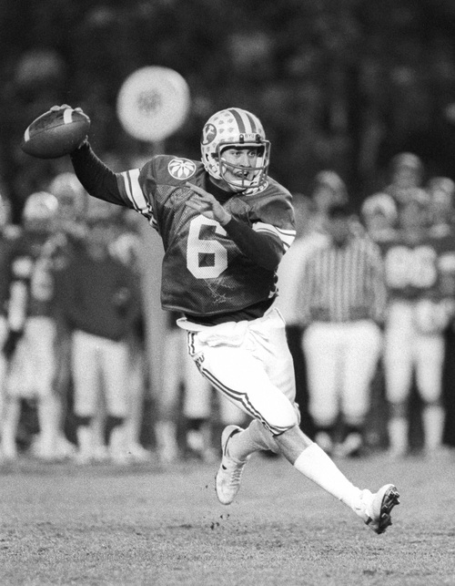 Robbie Bosco looks to pass in the Holiday Bowl against Michigan. December 21, 1984. Courtesy Mark Philbrick  |  BYU