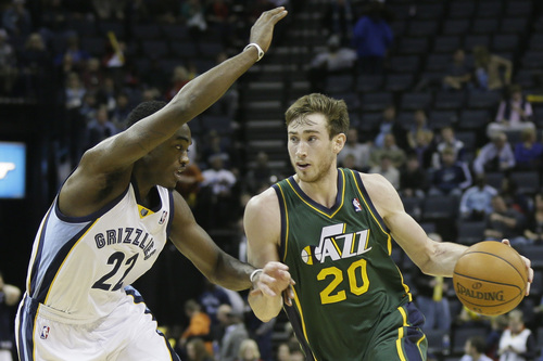 Danny Johnston | The Associated Press Utah's Gordon Hayward, right, trying to drive around Memphis' Jamaal Franklin on Monday, has become the focal point of opposing defenses following the departures of Al Jefferson and Paul Millsap during the offseason.